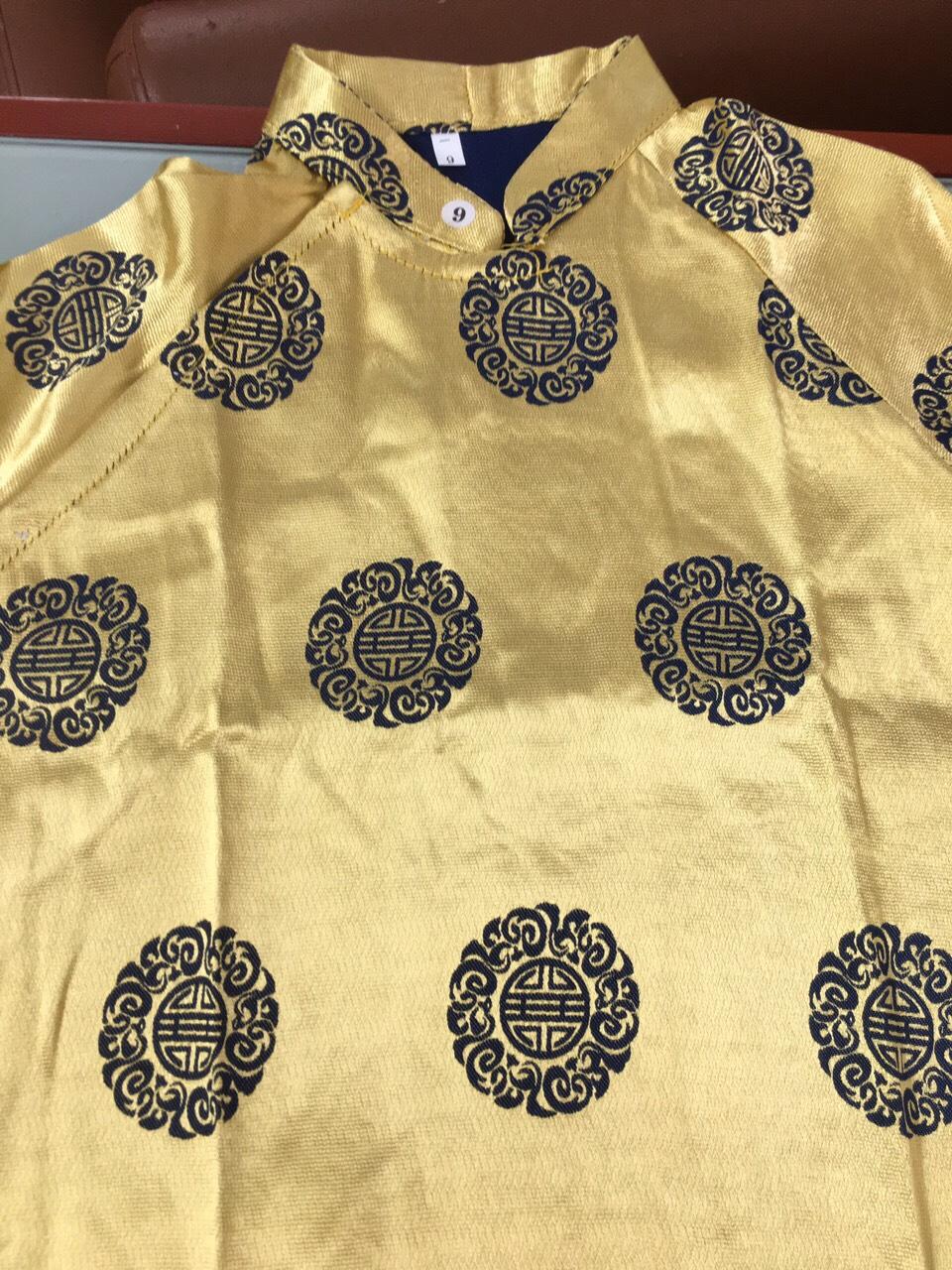 áo dài tết vàng gấm.jpg